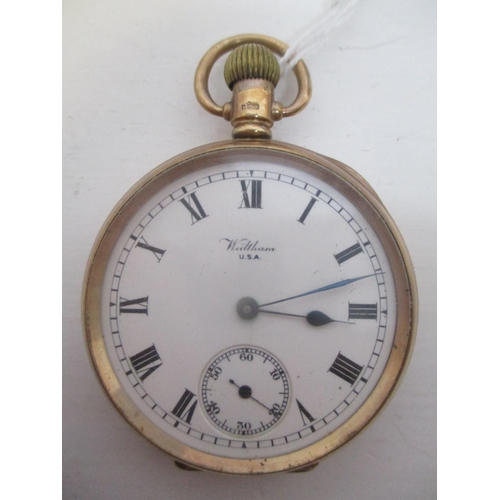 15 - An early 20th century Waltham 9ct gold, open face, keyless wound pocket watch. The white enamel dial...