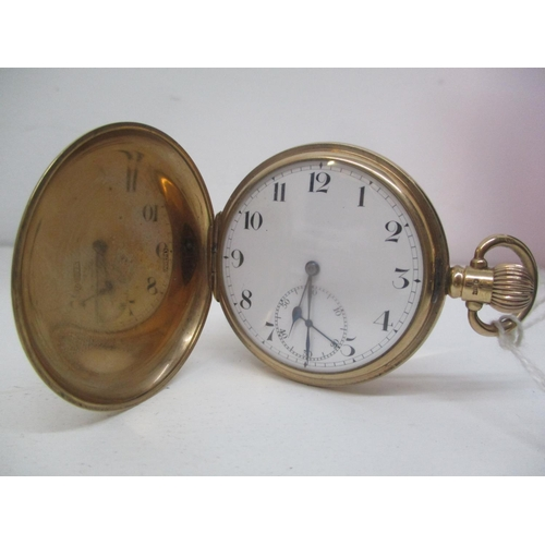 16 - An early 20th century Zenith 9ct gold full Hunter, keyless wound pocket watch.  The white enamel dia...