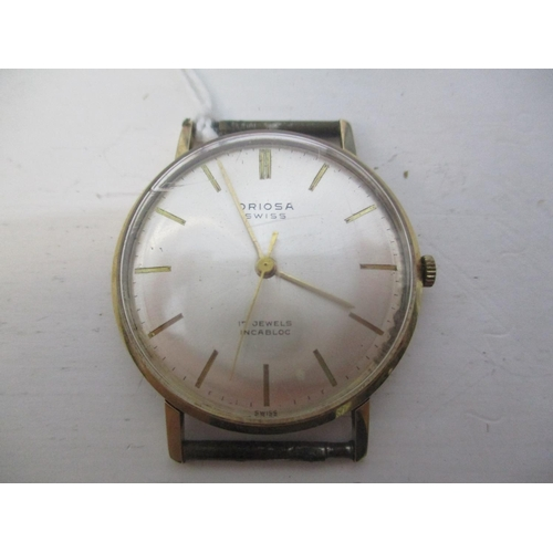 17 - An Oriosa gents 14ct gold, manual wind wristwatch. The silvered dial having baton markers and centre...