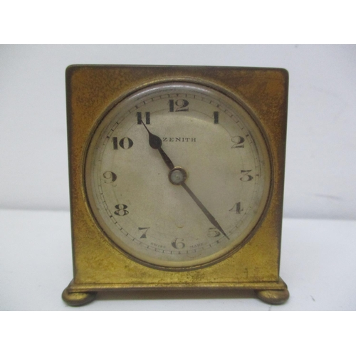 18 - An early 20th century brass cased travelling bedside alarm clock. The dial having Arabic numerals an...