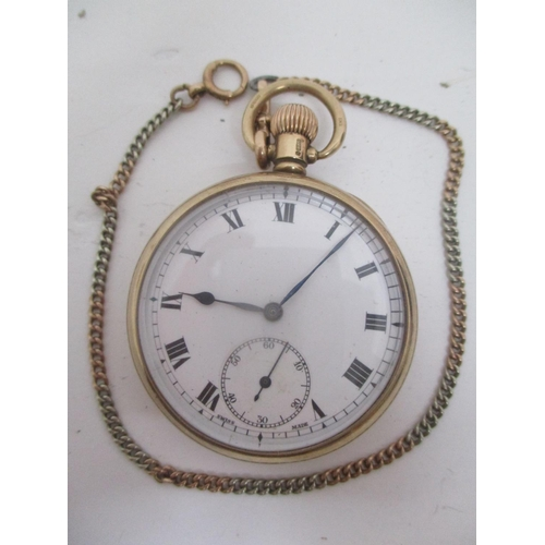 19 - An early 20th century 9ct gold, open face, keyless wound pocket watch. The white enamel dial having ...