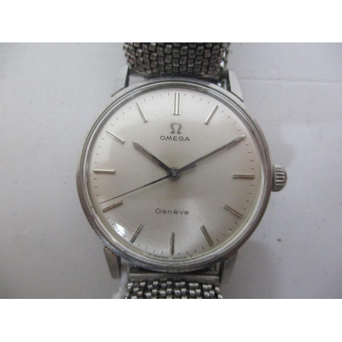 2 - An Omega Geneve gents stainless steel, manual wind wristwatch having a silver dial, baton markers an...