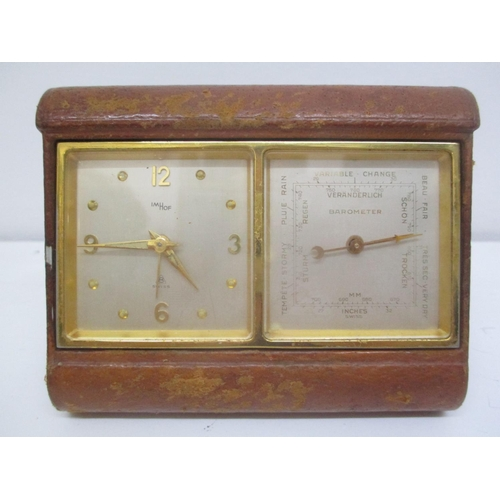 22 - An early 20th century IMHOF travel clock and Veranderlich barometer in a leather folding case. The c...