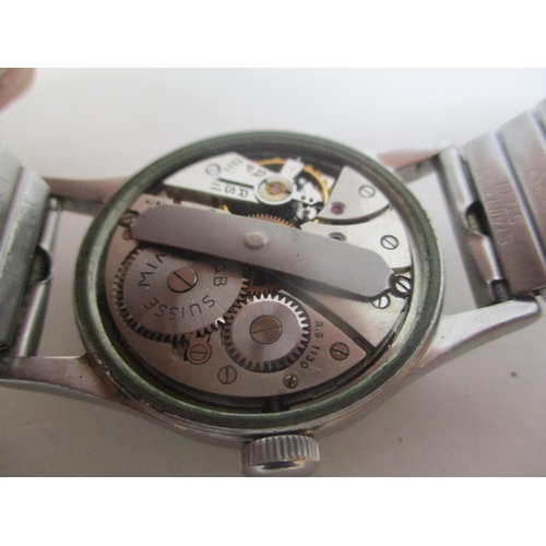 24 - A 1940s Mimo gents stainless steel, manual wind wristwatch. The black dial having Arabic numerals an...