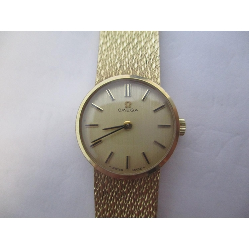 31 - An Omega ladies 9ct gold, manual wind wristwatch. The gilt coloured dial having baton  markers and t...