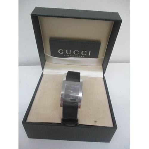 32 - A Gucci ladies stainless steel quartz wristwatch. The case back inscribed 7900L.1 and on a black lea...