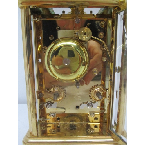 33 - A Mappin & Webb brass repeater carriage clock having white enamel dial with Roman numerals and Bregu...