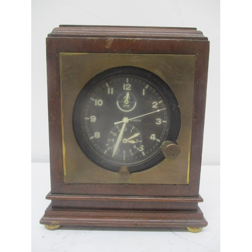 34 - An 8 day aircraft clock having a black dial with Arabic numerals and subsidiary dials, AM/PM and tim...