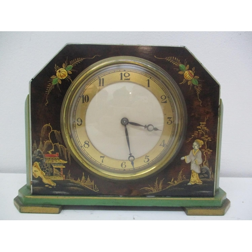 35 - A 1930s Japanned 8 day mantle clock decorated with figures and birds having gilt highlights. The pla...