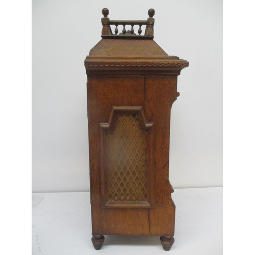 38 - LOT WITHDRAWN - A late 19th century oak cased mantle clock having a silvered dial with Roman numeral...