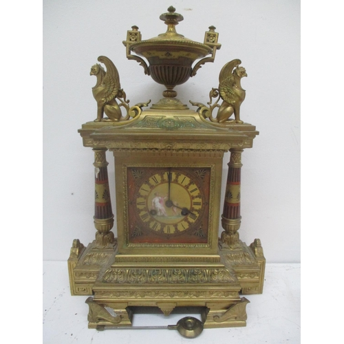 40 - A late 19th century French Empire style gilt brass mantle clock.  The case having an urn shaped fini...