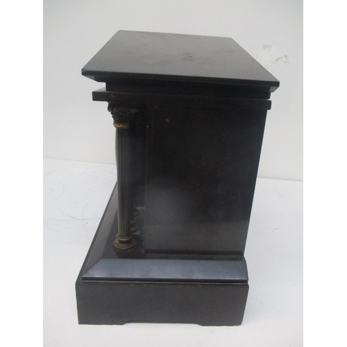 41 - A late 19th century French Samuel Marti black marble cased mantle clock.  The architectural case hav...