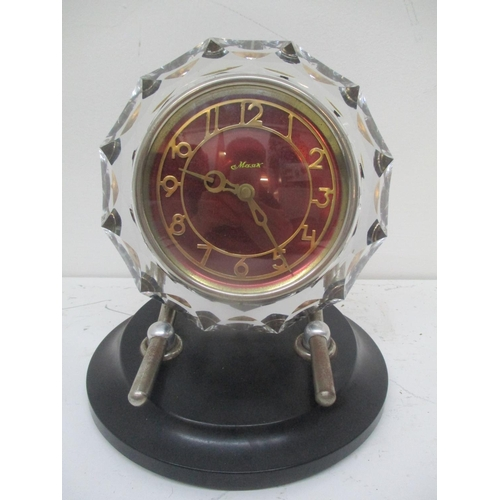 42 - A Vintage Russian glass mantle clock having a red dial inscribed Masik, with Arabic numerals and on ...