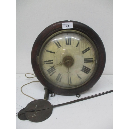 43 - A Victorian postman's alarm clock having a circular mahogany case, painted dial and striking on a be...