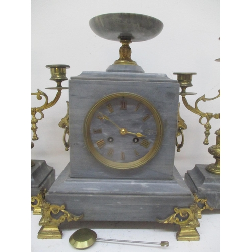 46 - A 19th century French marble and gilt metal mantle clock with two matching garnitures.  The clock su...