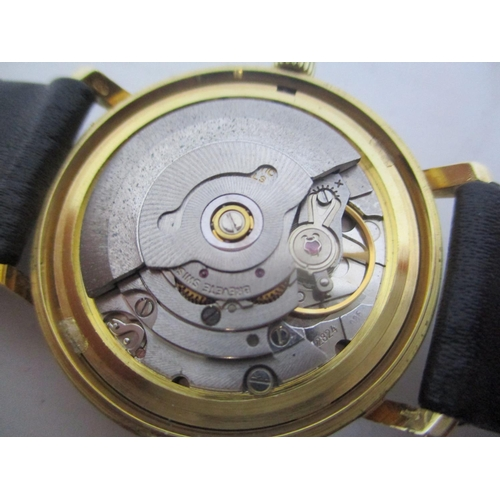 6 - An Eterna Matic gents 9ct gold automatic wristwatch having a silvered dial, baton markers, date aper...