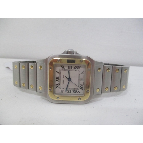 8 - A Cartier Santos gents, stainless steel and gold quartz wristwatch, model 1566. The square dial with...