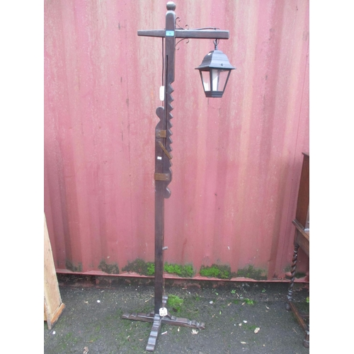 11 - An oak lantern standard lamp with adjustable column 75