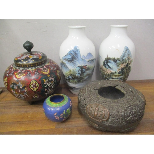 14 - Chinese and Japanese metalware and ceramics to include a pair of baluster vases, two cloisonne vases...