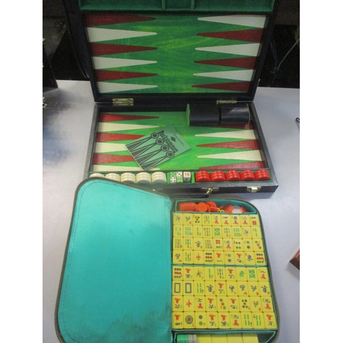 18 - A cased Mah Jong set, together with a Backgammon set Location: 1:3...