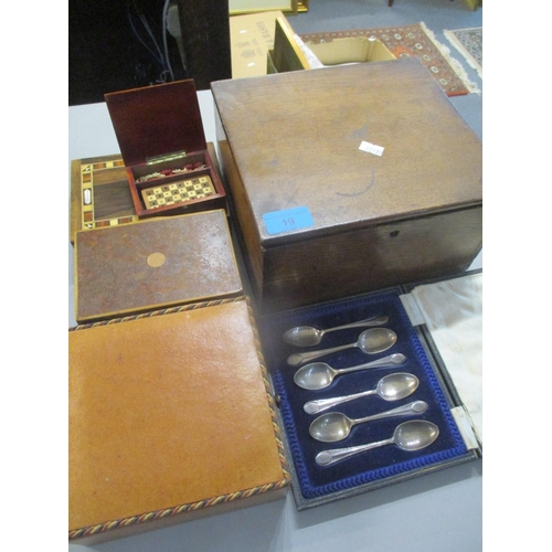 19 - A mixed lot to include a cased set of silver teaspoons, a miniature chess set, and mixed books Locat...