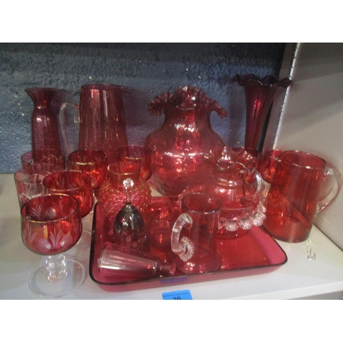 20 - A selection of cranberry glassware to include a posy vase, jug and others Location: 9:4...