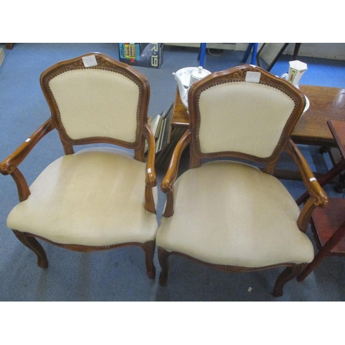 23 - A pair of mid 20th century French walnut armchairs having scrolled arms and cabriole legs Location: ...