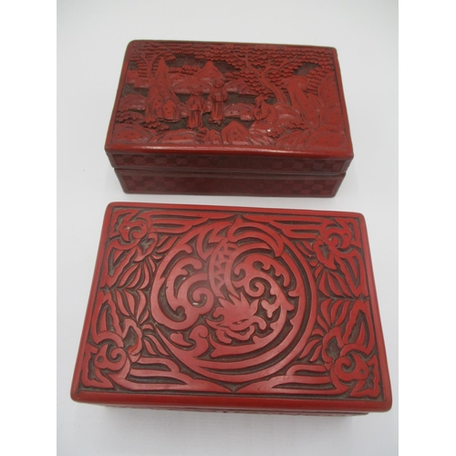 25 - Two red Cinnabar boxes to include early 20th century Chinese example depicting figures in a landscap...