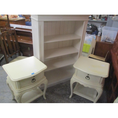 31 - A modern cream open front bookcase, together with a pair of two tier French style lamp tables Locati...