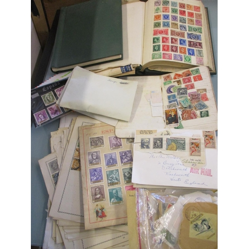 34 - A quantity of 20th century worldwide stamps to include Chinese stamps, two albums, a stock book and ...