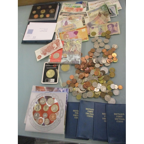 35 - Mixed worldwide banknotes and coins, four Britain's First Decimal Coin packs, proof sets, and a Brit...