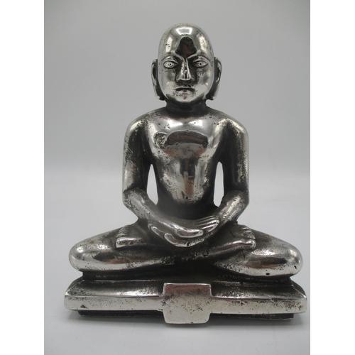 36 - A Tibetan silver coloured figure of a Buddha on a plinth, 6