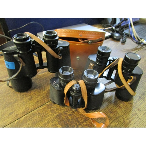 52 - A group of three binoculars to include a Boots empire made 8 x 30 example Location: 4:1...