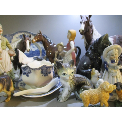 57 - A mixed lot of ceramic and resin horses and other animal ornaments, along with a collection of minia...