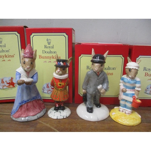 6 - Four boxed Royal Doulton Bunnykins ornaments to include Sundial, Beefeater, Businessman and Mother L...