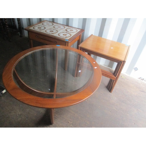 9 - Mid 20th century teak furniture consisting of a nest of tables, a glass topped Astro coffee table an...