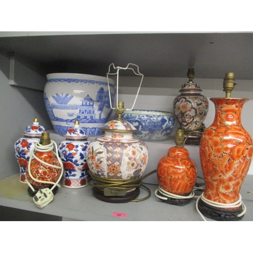 29 - A selection of oriental items to include fish bowl, table lamps and other items Location: G...