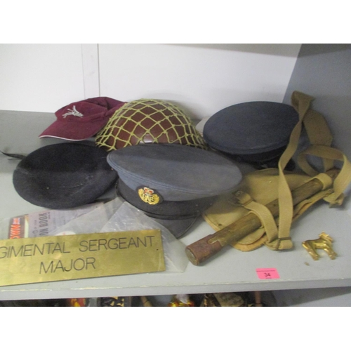 34 - Military related items to include RAF caps and others, a spade and other items Location: G...