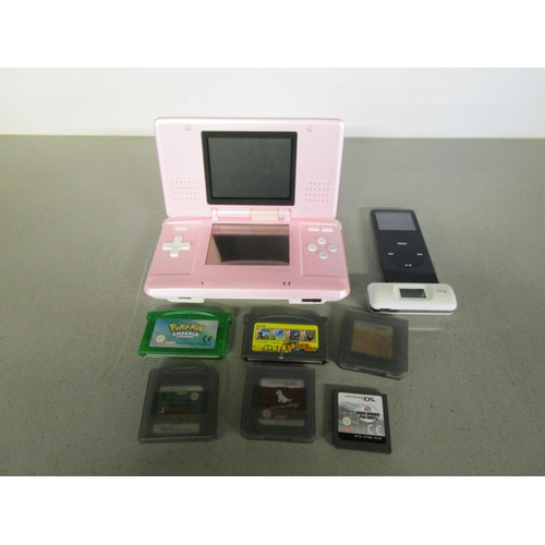 43 - Nintendo DS NTR 001 (missing leads), 2004 IPod 4 ab missing lead, with various Nintendo games Locati...