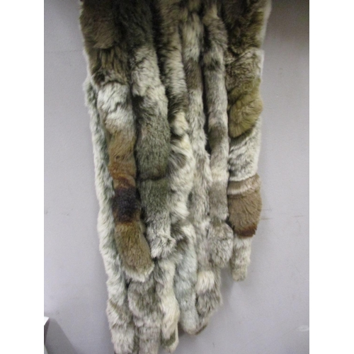 48 - A French Tissavel faux fur jacket together with a multi tail fur scarf and a quantity of faux fur re...