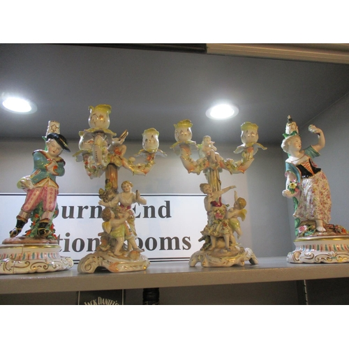 69 - A pair of porcelain candelabras and a pair of figural stands Location: 7:1...