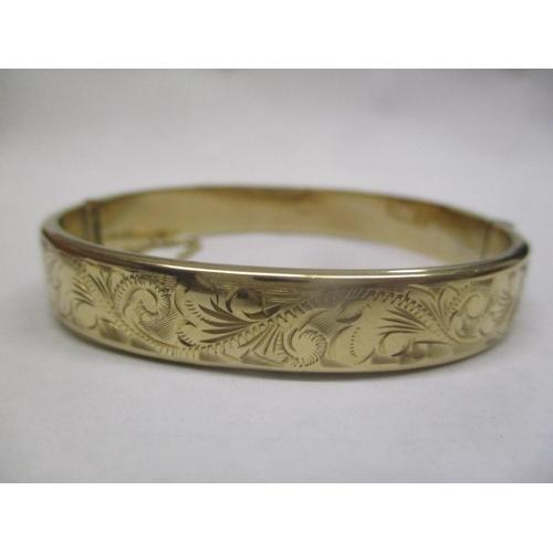 1 - A 9ct gold bangle Location: CAB...