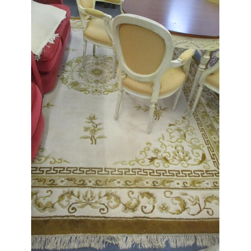 12 - A large Indian cream and mustard coloured rug, 143 x 112 Location: C...