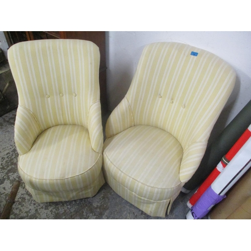 14 - A pair of Victorian salon chairs upholstered in a yellow and white fabric, on turned mahogany legs L...