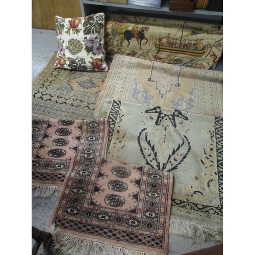 16 - Five mixed Middle Eastern rugs, together with a Laura Ashley cushion and a tapestry wall hanging Loc...