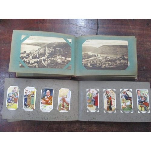 17 - An early 20th century postcard album, together with a cigarette card album, some silk examples Locat...