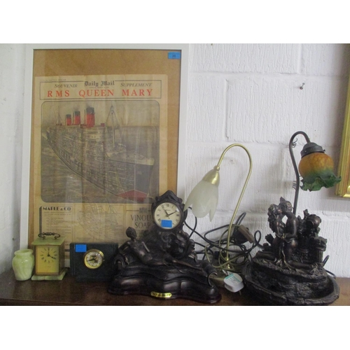 20 - A mixed lot to include table lamps, clocks and a 1936 Daily Mail framed newspaper advertising RMS Qu...
