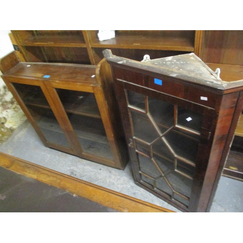 21 - A Georgian mahogany astrigal glazed corner cabinet, together with a wall hanging bookcase Location: ...