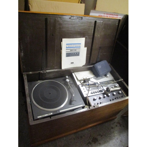 29 - Mixed audio equipment to include a Pioneer turntable and a Sansui amplifier, contained in a Victoria...