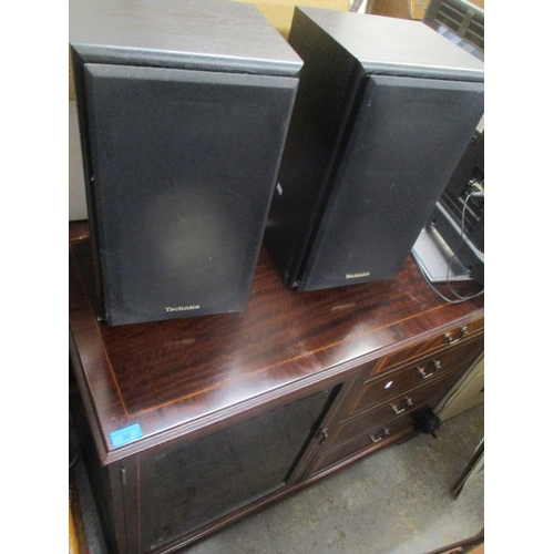 30 - A reproduction mahogany music cabinet containing a Technics stacking system with speakers Location: ...